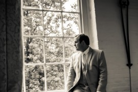 Groom waiting for Bride at The Great Room at Savage Mill